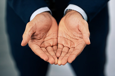Buy stock photo Closeup shot of an unrecognizable businessman standing with his hands cupped together