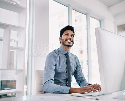Buy stock photo Cropped shot of a handsome young man working at his desk