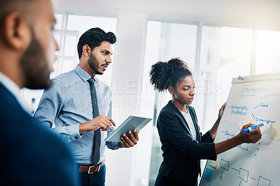 Buy stock photo Cropped shot of businesspeole having a brainstorming session at workv