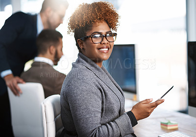 Buy stock photo Cropped portrait of an attractive young businesswoman working at her desk in a modern office