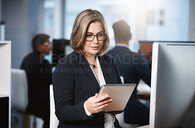 Buy stock photo Cropped shot of an attractive young businesswoman working at her desk in a modern office