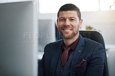 Buy stock photo Portrait of a mature businessman using a computer at his desk in a modern office