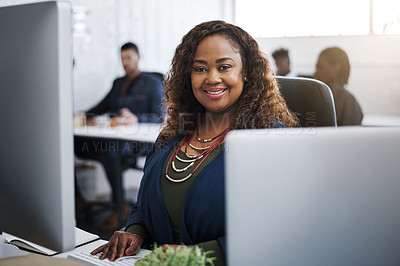 Buy stock photo Portrait of a happy young businesswoman at her desk in a modern office