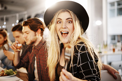 Buy stock photo Cropped shot of a young woman enjoying herself at a get together between friends