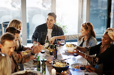 Buy stock photo Shot of friends getting together for a dinner party