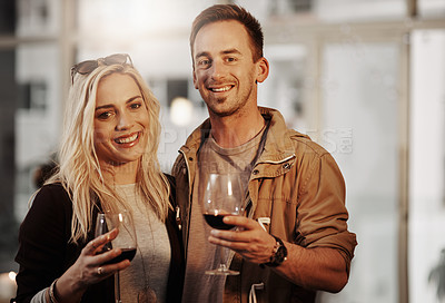 Buy stock photo Cropped portrait of an affectionate young couple enjoying a glass of wine