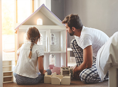 Buy stock photo Shot of a father spending quality time with his little daughter at home