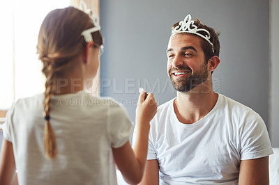 Buy stock photo Cropped shot of a little girl putting makeup on her father