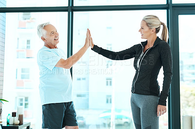 Buy stock photo Shot of a physiotherapist and her senior patient standing together