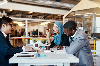 Buy stock photo Shot of a group of confident young businesspeople having a meeting together in the office at work during the day
