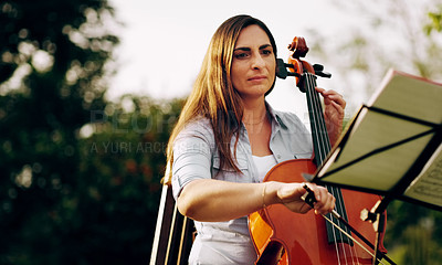 Buy stock photo Cropped shot of a beautiful woman playing a cello in the backyard