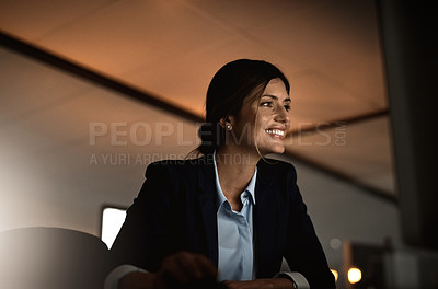 Buy stock photo Shot of a young businesswoman working online during a late night in a modern office