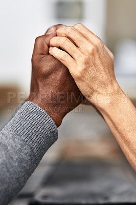 Buy stock photo Cropped shot of an unrecognizable senior couple holding hands in prayer while sitting outside