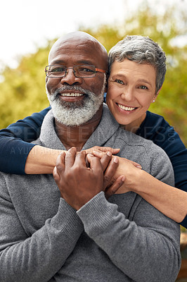 Buy stock photo Cropped portrait of an affectionate senior couple enjoying some quality time in the park