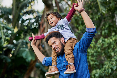 Buy stock photo Cropped shot of a single father out at the park with his son