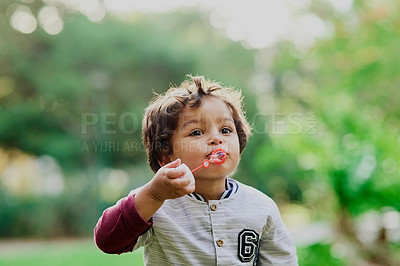 Buy stock photo Shot of an adorable little boy having fun outdoors