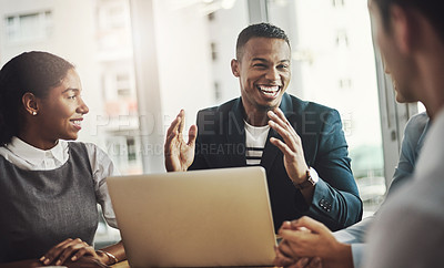 Buy stock photo Cropped shot of a handsome young businessman addressing his colleagues during a meeting in the boardroom