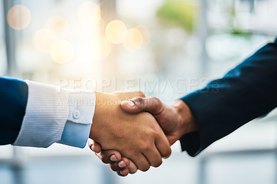 Buy stock photo Cropped shot of two unrecognizable businesspeople shaking hands while standing in their office