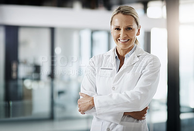 Buy stock photo Cropped portrait of an attractive mature female scientist standing with her arms folded in her lab