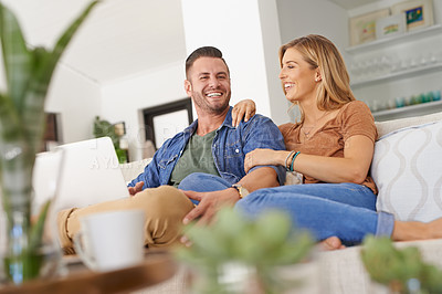Buy stock photo Shot of an affectionate couple relaxing at home