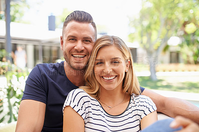 Buy stock photo Cropped portrait of an affectionate and happy couple relaxing outside in their backyard