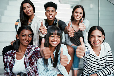 Buy stock photo Portrait of a group of university students showing thumbs up at campus