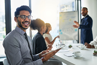 Buy stock photo Cropped shot of a businessman using a digital tablet while sitting in a meeting