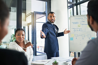 Buy stock photo Shot of a confident businessman delivering a presentation in the boardroom