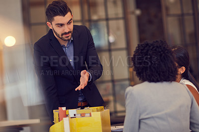 Buy stock photo Cropped shot of young businesspeople having a meeting in the office
