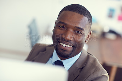 Buy stock photo Portrait of a young handsome businessman in the office