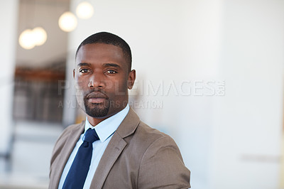 Buy stock photo Portrait of a handsome young businessman in the office