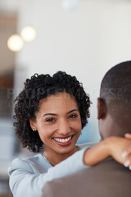 Buy stock photo Cropped shot of a young couple embracing each other in the office
