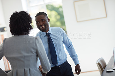 Buy stock photo Cropped shot of  a businessman and businesswoman shaking hands in the office