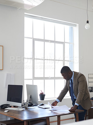 Buy stock photo Cropped shot of a young businessman in the office
