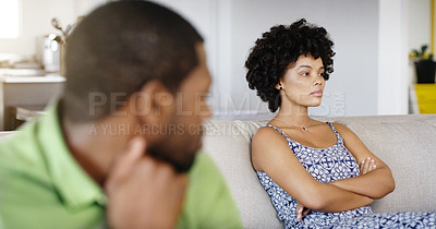 Buy stock photo Cropped shot of a young married couple having a disagreement at home