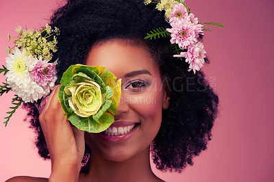 Buy stock photo Studio shot of a beautiful young woman posing with flowers against a pink background
