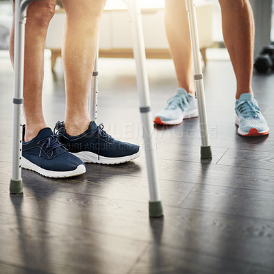 Buy stock photo Closeup shot of a physiotherapist assisting a senior patient with a walker while in recovery