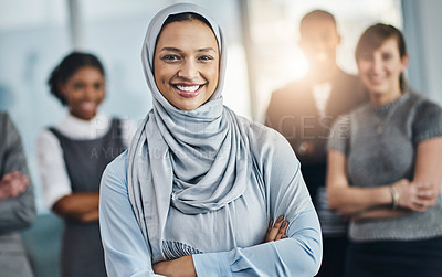 Buy stock photo Portrait of confident young business people standing with their arms folded inside of the office at work during the day