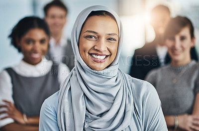 Buy stock photo Portrait of a confident young businesswoman standing inside the office at work