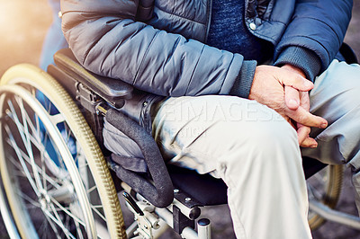 Buy stock photo High angle shot of an unrecognizable senior wheelchair-bound man sitting in the park