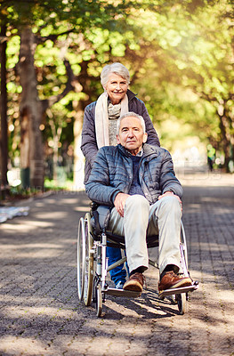 Buy stock photo Full length portrait of a wheelchair-bound senior man spending the day with his wife in the park