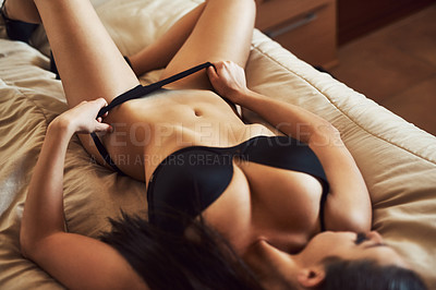 Buy stock photo High angle shot of a sexy young woman in her bedroom at home
