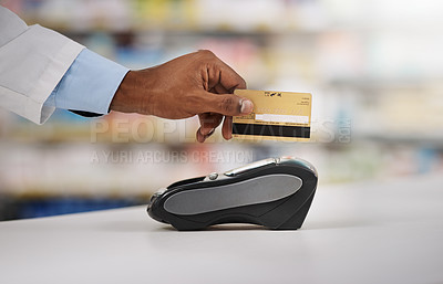 Buy stock photo Closeup shot of an unrecognizable pharmacist processing a credit card payment in a chemist