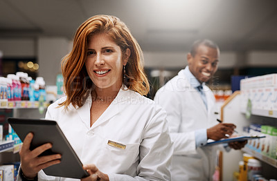 Buy stock photo Portrait of two pharmacists working together in a chemist