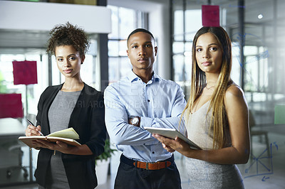 Buy stock photo Portrait of a group of young businesspeople working together in a modern office