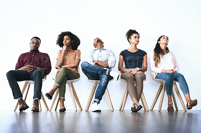 Buy stock photo Shot of a group of diverse people waiting in line to be interviewed