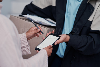 Buy stock photo Cropped shot of an unrecognizable man making a delivery while a female customer signs on a smartphone