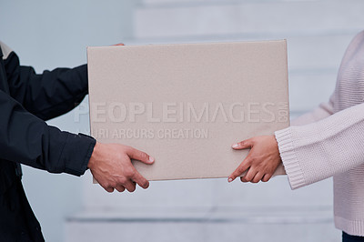Buy stock photo Cropped shot of an unrecognizable man making a delivery to an unrecognizable female customer