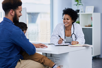 Buy stock photo Shot of a single father bringing his little boy for a checkup