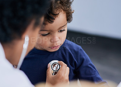 Buy stock photo Shot of a female doctor checking her young patient's heart rate